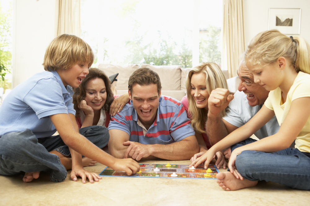Family-playing-a-board-game-together-on-the-floor